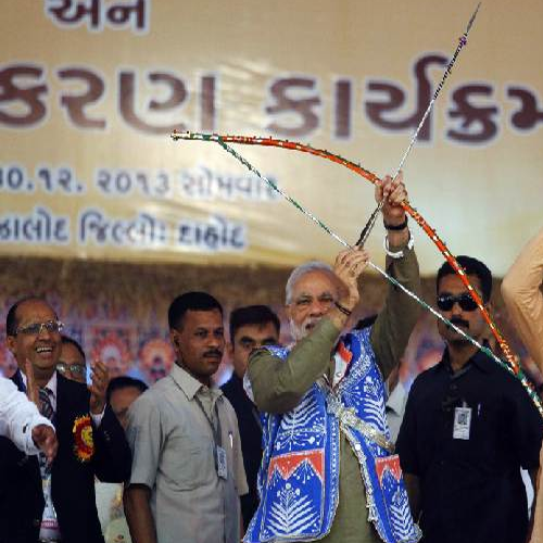 Narendra Modi holds a bow and arrow