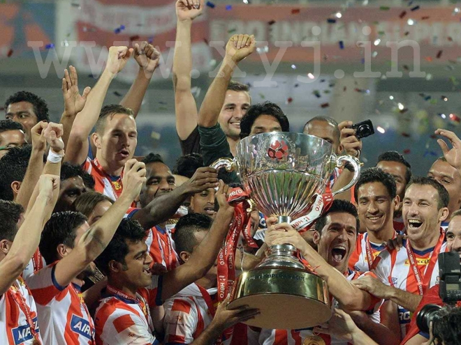 Atletico de Kolkata Players with trophy ISL winning moment of ATK